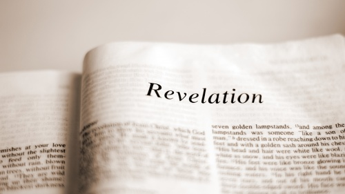 A Bible opened to the book of Revelation.