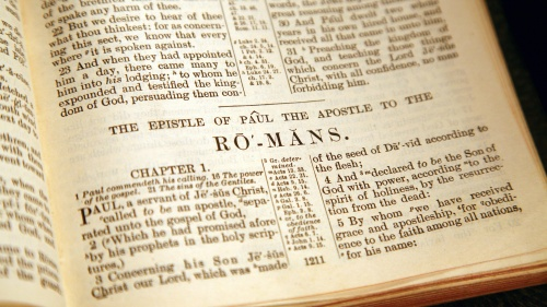 A Bible opened to the book of Romans.