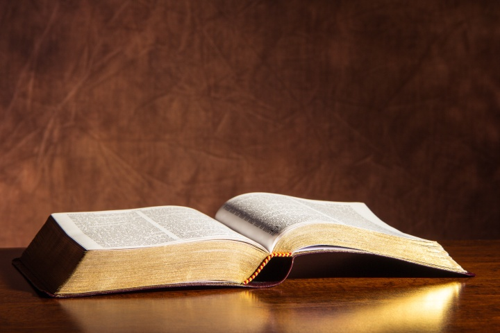 An open Bible on a table.