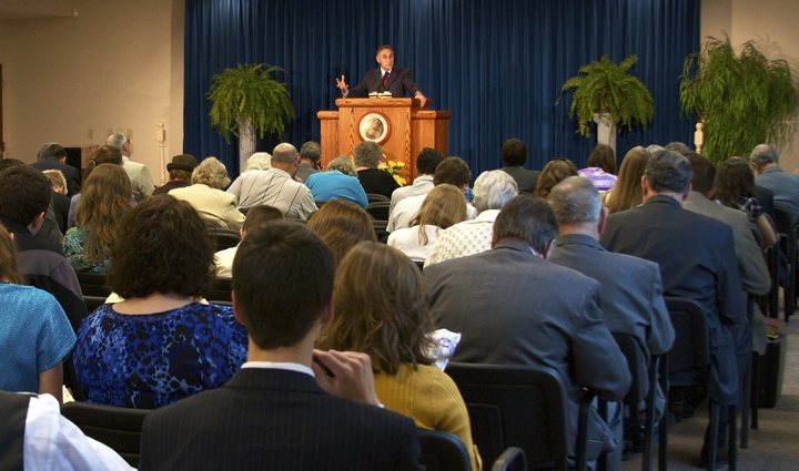 A church congregation listening to a sermon.